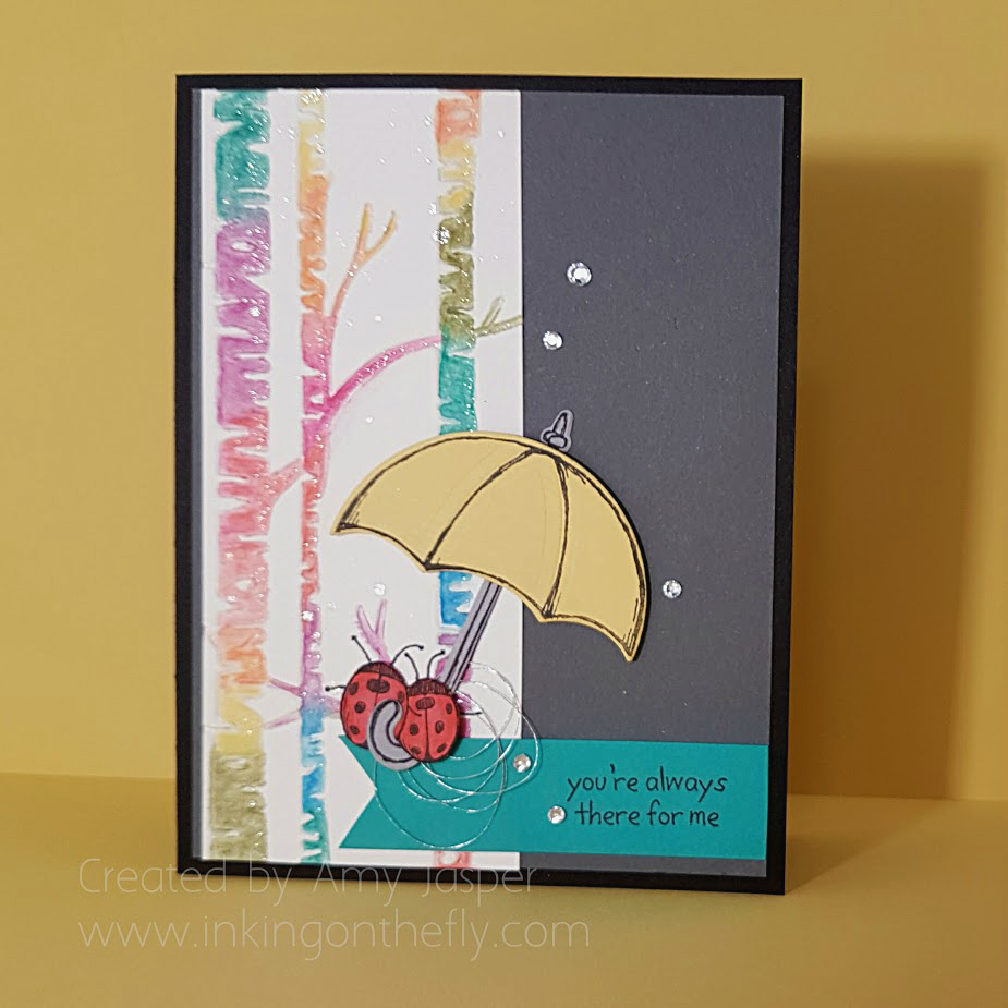 April Showers card with Stampin' Up Woodland Embossing folder and Watercolor Pencils by Amy Jasper www.inkingonthefly.com